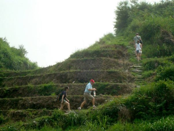 Climbing the rice paddies in Guangxi, China.