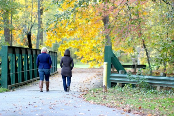 My friend, Abbie, and I walk on the canal path this fall in Princeton.  Photo by Evan Schneider.