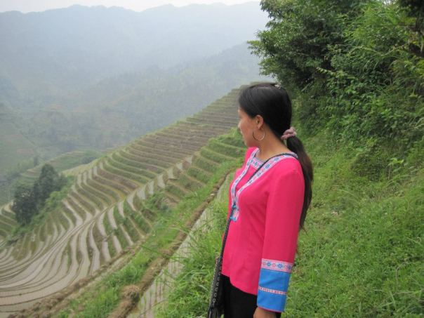 This is our guide, Xiao Pan, looking out on the rice terraces outside her Yao village, Zhongliu, in the Guangxi mountains.  Photo by David Raffety.