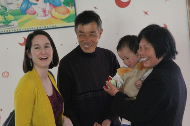 Talking with foster parents in Hubei, China.  In addition to this foster baby, this sweet couple had twins who were napping when we visited, and of course we loved gabbing about how I'm a twin, too!