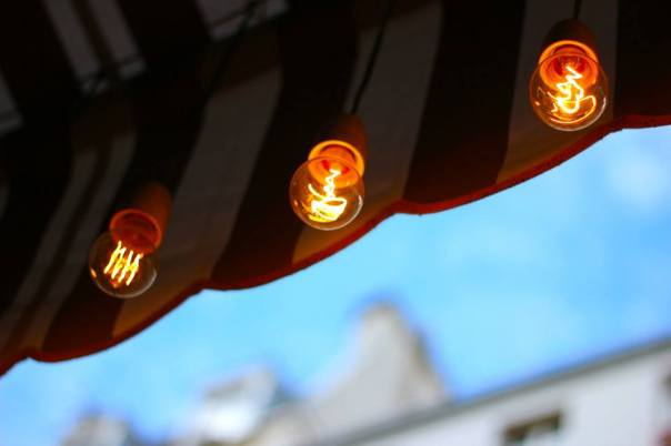 Light bulbs over a Paris cafe.