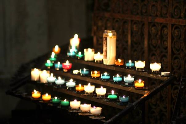 Prayer candles in a cathedral.  Photo by Evan Schneider.