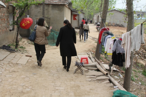 Visiting foster homes with an orphanage director in Anhui.  Photo by Jason Fouts.