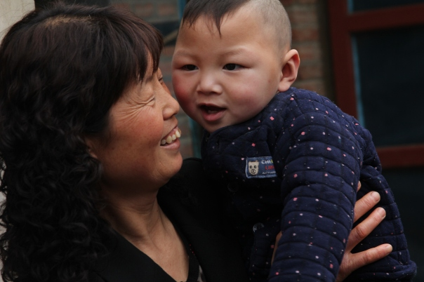 A foster mother and her son in Anhui, China.  Photo by Jason Fouts.