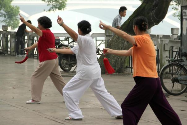 Ladies doing tai chi along the Li River in Guilin, Guangxi.
