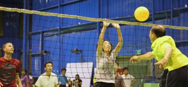 My husband plays volleyball with the teachers from his college.  My photo.