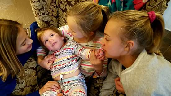 Lucia with her cousins this Christmas.  Photo by Arwin Ray.